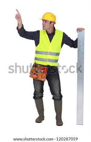Worker in a reflective vest - stock photo