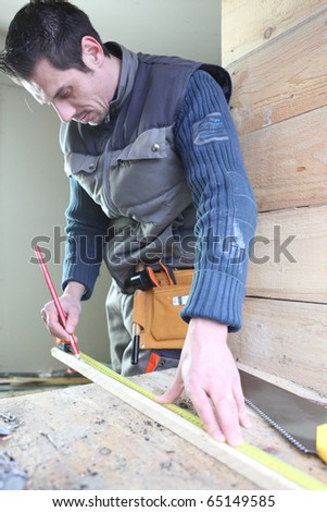 Worker in a room under construction - stock photo