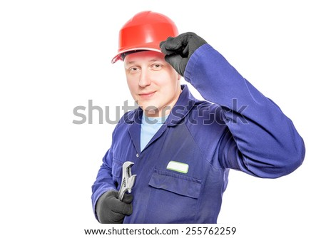 Worker in blue overall with wrench isolated over white background