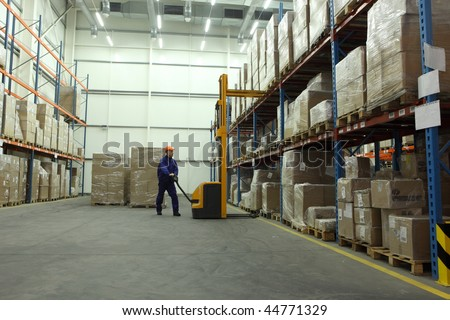 worker in blue uniform in the warehouse