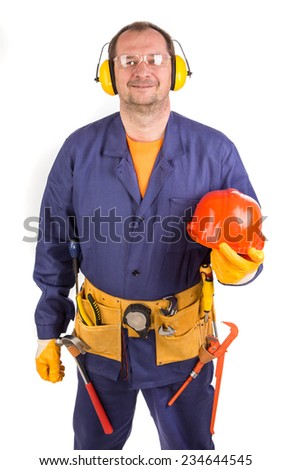Worker in ear muffs holding hard hat. Isolated on a white background. - stock photo