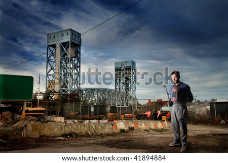 worker in erection yard - stock photo