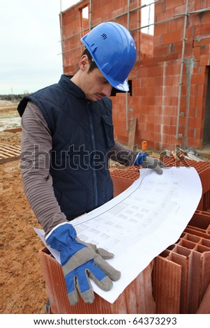 Worker in front of a site plan