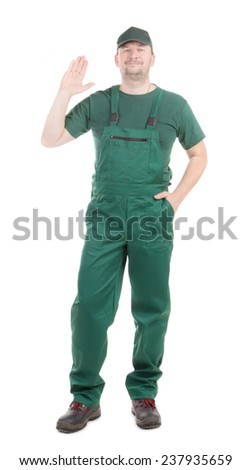 Worker in green overalls with great sign. Isolated on a white background.