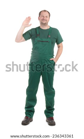 Worker in green overalls with ok sign. Isolated on a white background. - stock photo