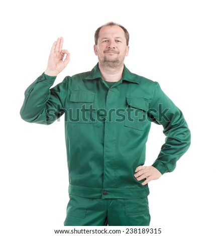 Worker in green with great sign. Isolated on a white background. - stock photo