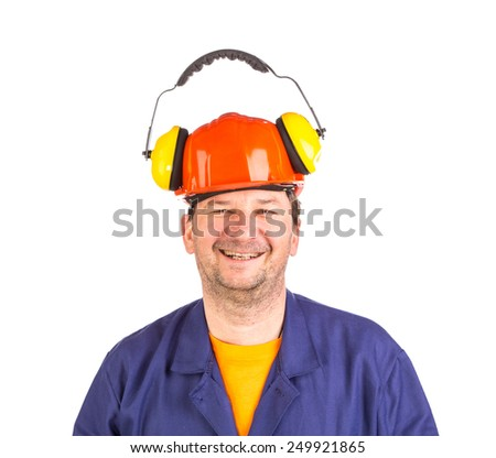 Worker in hard hat and ear muffs. Isolated on a white background. - stock photo