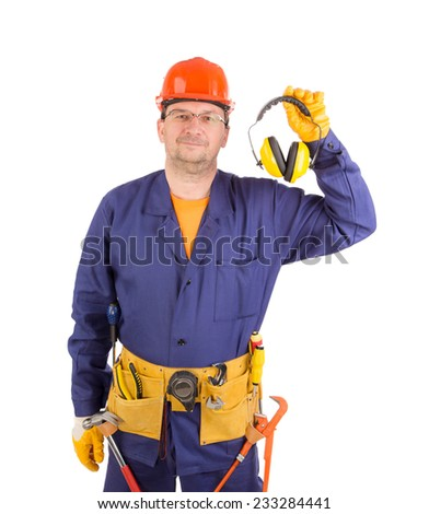 Worker in hard hat holding ear muffs. Isolated on a white background. - stock photo