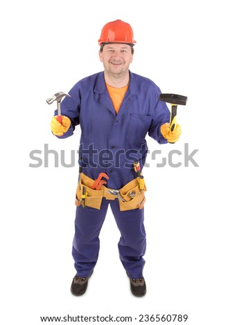 Worker in hard hat holding hammers. Isolated on a white background. - stock photo