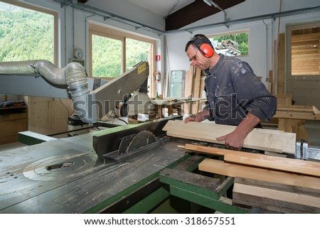 worker in joinery workshop - stock photo