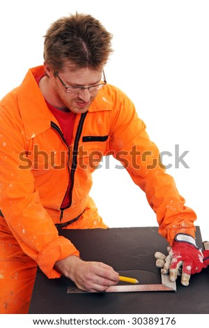 worker in orange work-wear measuring with a ruler - stock photo