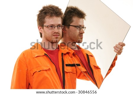 worker in orange workwear carries a mirror, isolated on white - stock photo