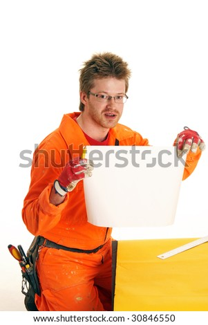 worker in orange workwear holds the sheet of white paper, isolated on white - stock photo