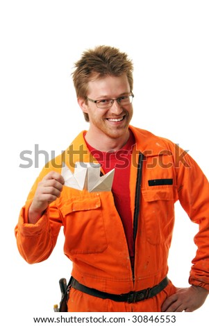 worker in orange workwear holds the toy-ship built from a paper, isolated on white - stock photo