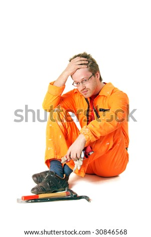 worker in orange workwear with tools, isolated on white - stock photo