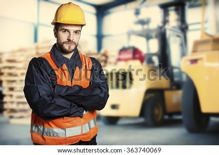 Worker in protective uniform in front of forklift - toned image, retro film filtered in instagram style - stock photo