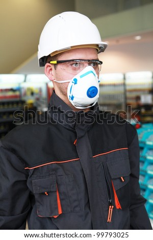 Worker in protective workwear - stock photo
