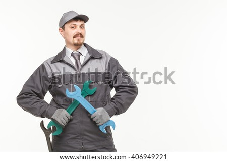 Worker in uniform with wrench isolated white background - stock photo