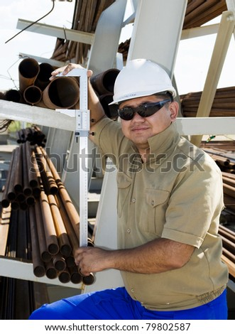 worker in warehouse checks the pipe