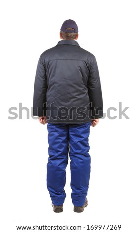 Worker in winter workwear. Back view. Isolated on a white background.