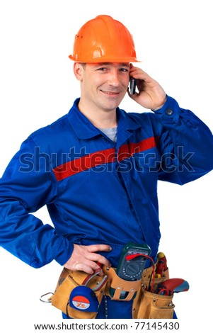 Worker in work wear with modern mobile phone against white - stock photo