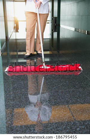 worker is cleaning the floor in an office building - stock photo
