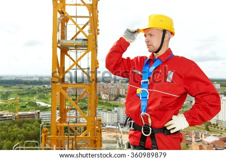 worker joiner at building site - stock photo