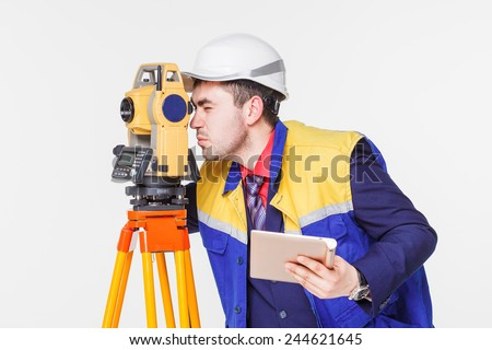 Worker looking into the level - stock photo