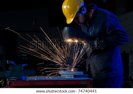 Worker making sparks while welding steel - a series of METAL INDUSTRY images. - stock photo