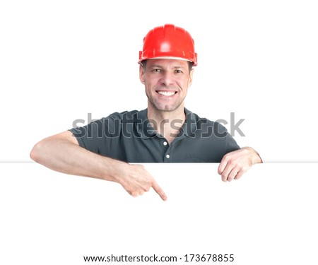Worker man in red helmet isolated on white background - stock photo