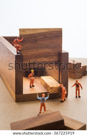 Worker moving goods package out from store. - stock photo