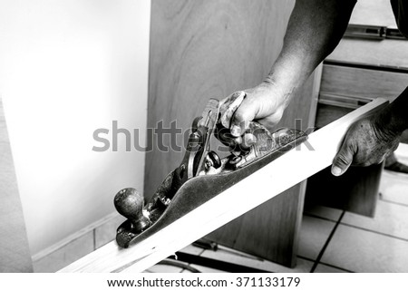 Worker of the construction arming a wood closet. Do it yourself - stock photo