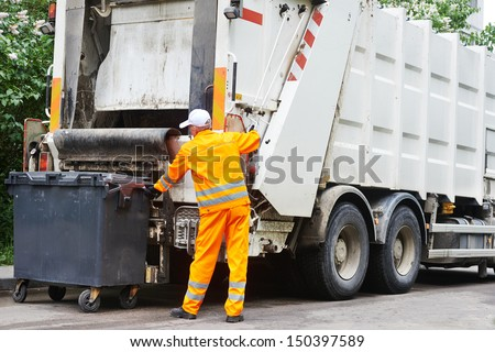 Worker of urban municipal recycling garbage collector truck loading waste and trash bin - stock photo