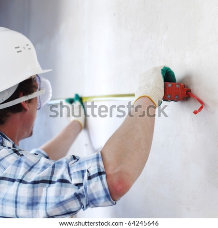 worker often with a measuring tape - stock photo