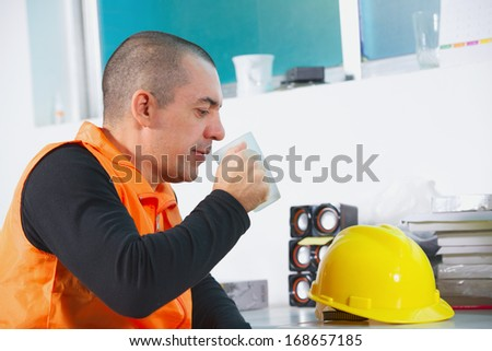 worker on a break drink coffee and have rest - stock photo