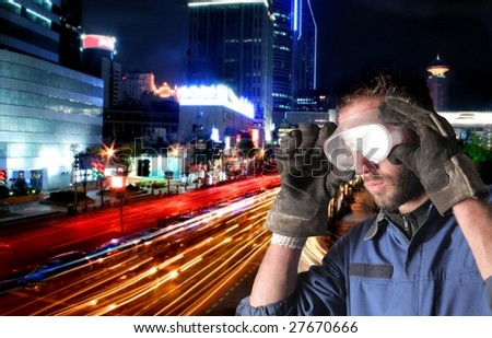 Worker on a city scape background - stock photo