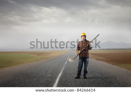 Worker on a countryside road - stock photo