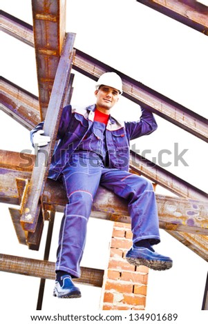 worker on a steel beam raises his hands sitting on the metal structure metal beam - roof frame, Under construction isolated on white background - stock photo