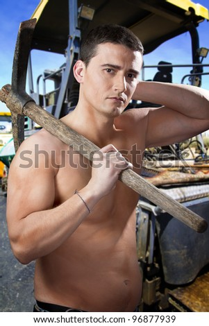 Worker on asphalting spreader machine during Road street repairing works - stock photo