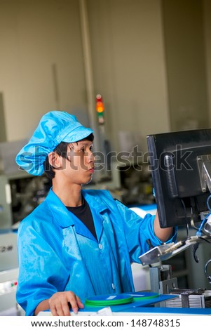 worker on chinese LED production factory - stock photo