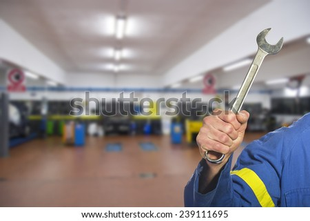 worker on the shop floor while repairing a car - stock photo