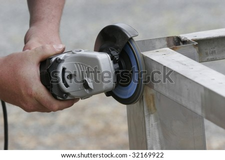 worker polishing a metal table