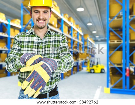 worker portrait in classic storage warehouse - stock photo