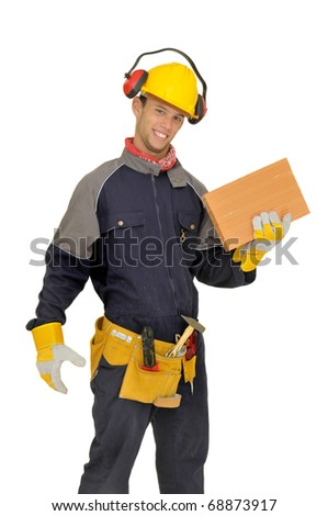 Worker posing with brick isolated in white