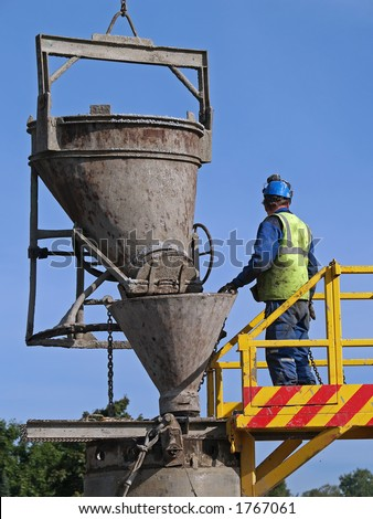 Worker pours cement into the well, close-up - stock photo