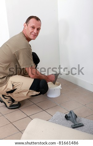 Worker preparing a wall - stock photo
