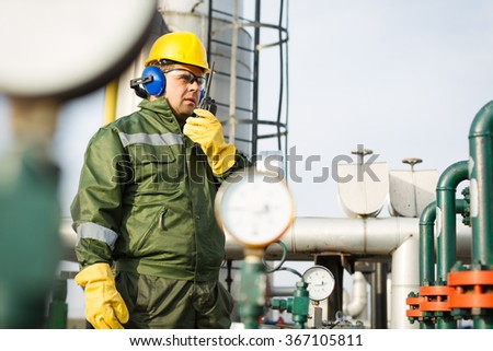 Worker produce oil - stock photo