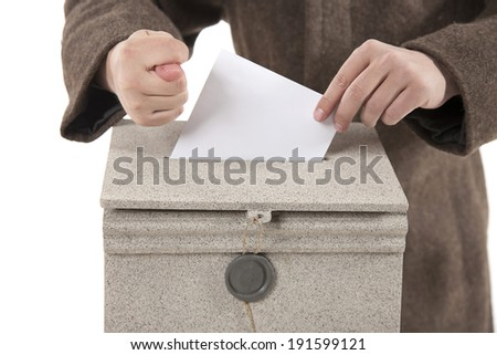 worker putting letter in mailbox,showing a fig sign on white background