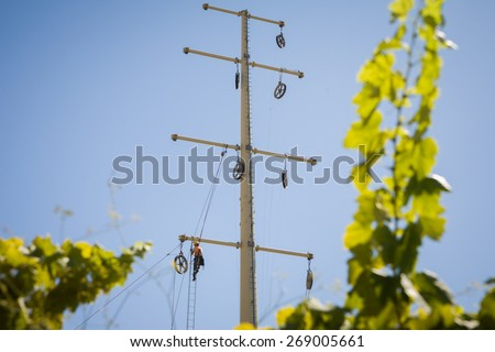 Worker repairing a high voltage industrial power energy line. Great for energy, safety and technology themes: Almada, Portugal - September 01, 2008   - stock photo