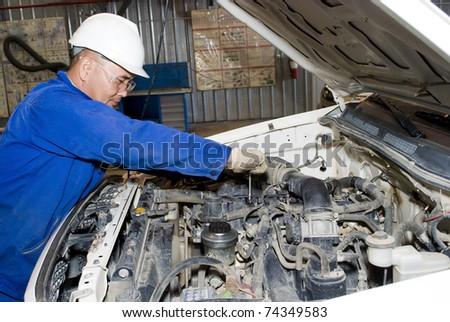 worker repairs engine - stock photo
